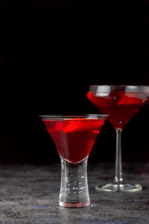 A vertical view of the red martini, short glass in front