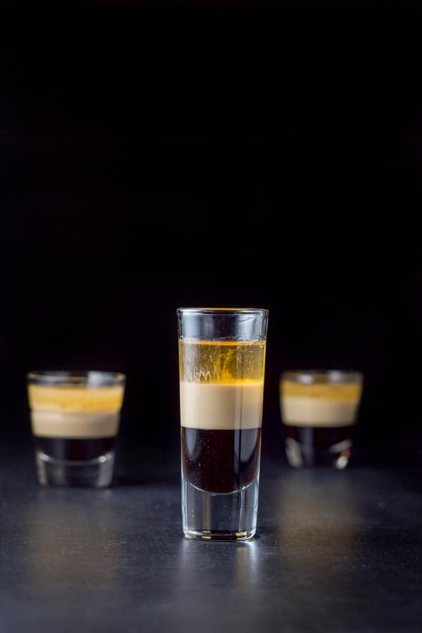 Vertical view of the tall layered shot showing obvious layers. There are two other glasses in the background