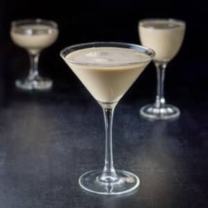 The creamy cocktail in three glasses. A classic glass, a coupe and a Nick and Nora glass - square