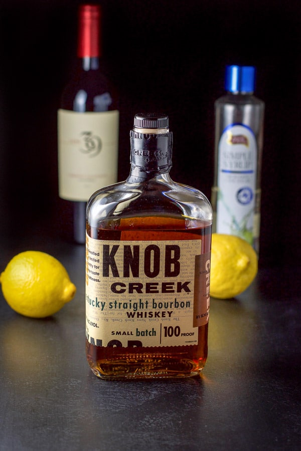 The ingredients - bourbon, lemon, simple syrup and wine