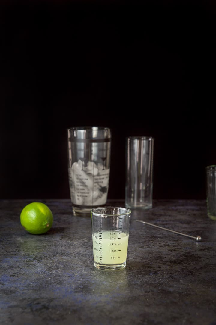 Lime measured out with a lime, shaker and glassware in the background