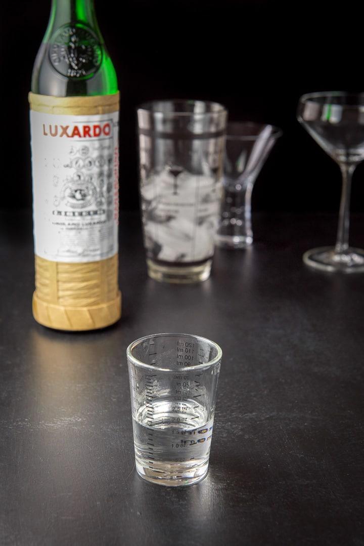 maraschino liqueur measured for the aviation cocktail recipe