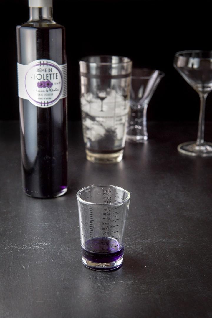 Creme de violette measured for the aviation cocktail recipe