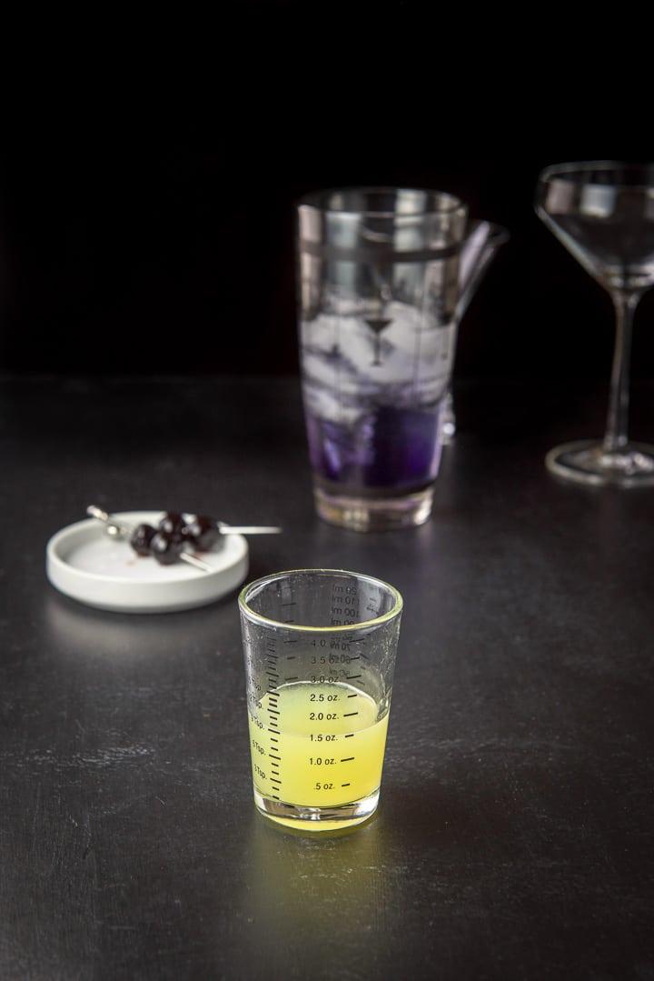 Fresh lemon juice measured for the aviation cocktail recipe