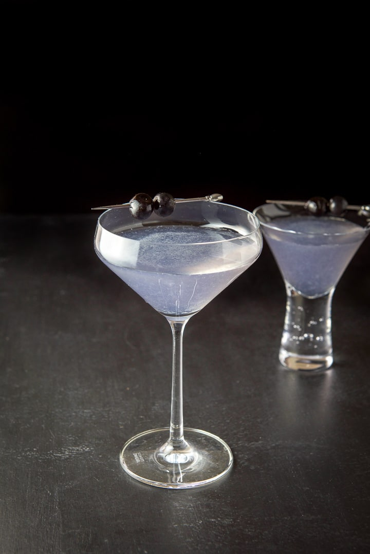 The aviation cocktail recipe poured into the two glasses. The tall glass is in front