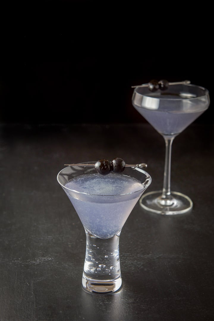 The aviation cocktail recipe poured out and the short glass in front