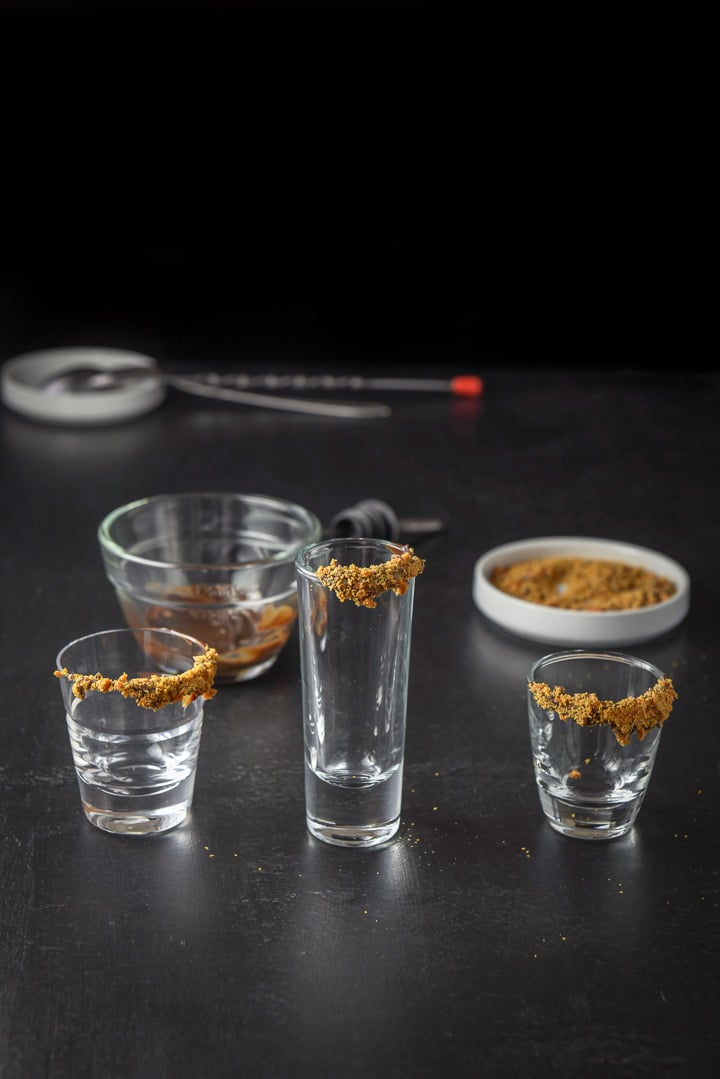 Butterfinger candy bar sprinkled on the rim of the shot glasses for the Butterfinger shot