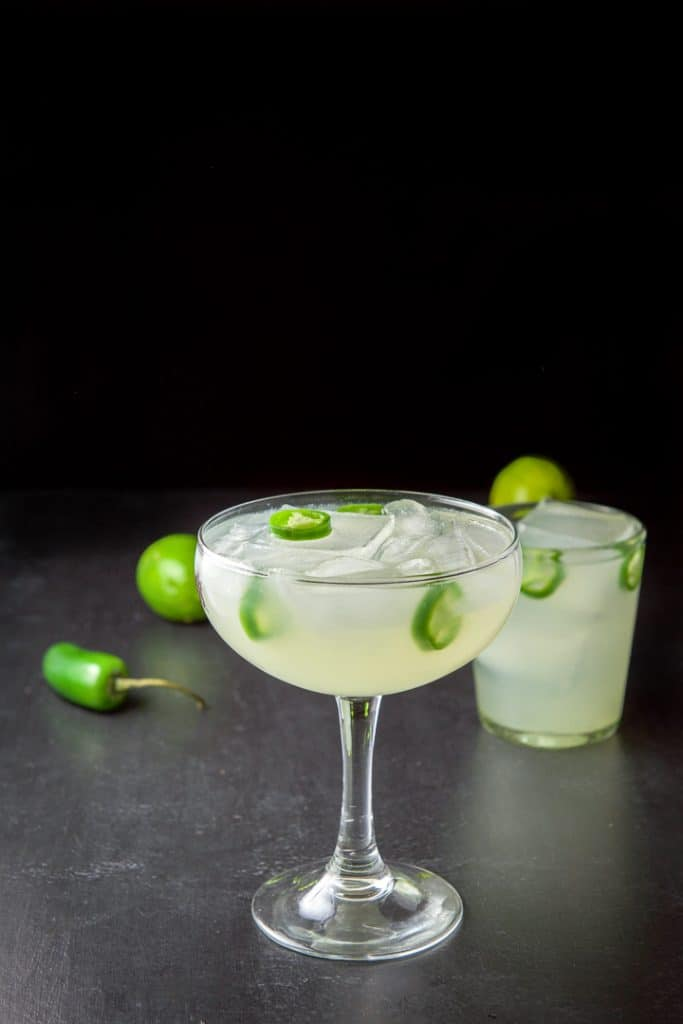 The Jalapeño margarita in the big bowl glass in front of the shorter glass