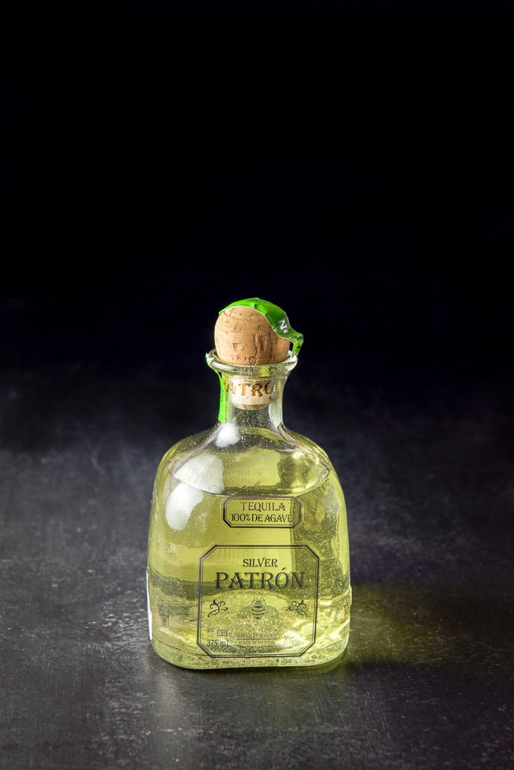 Infused tequila poured back into the bottle with the cork in it