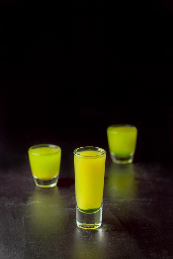 Orange juice layered into the three glasses