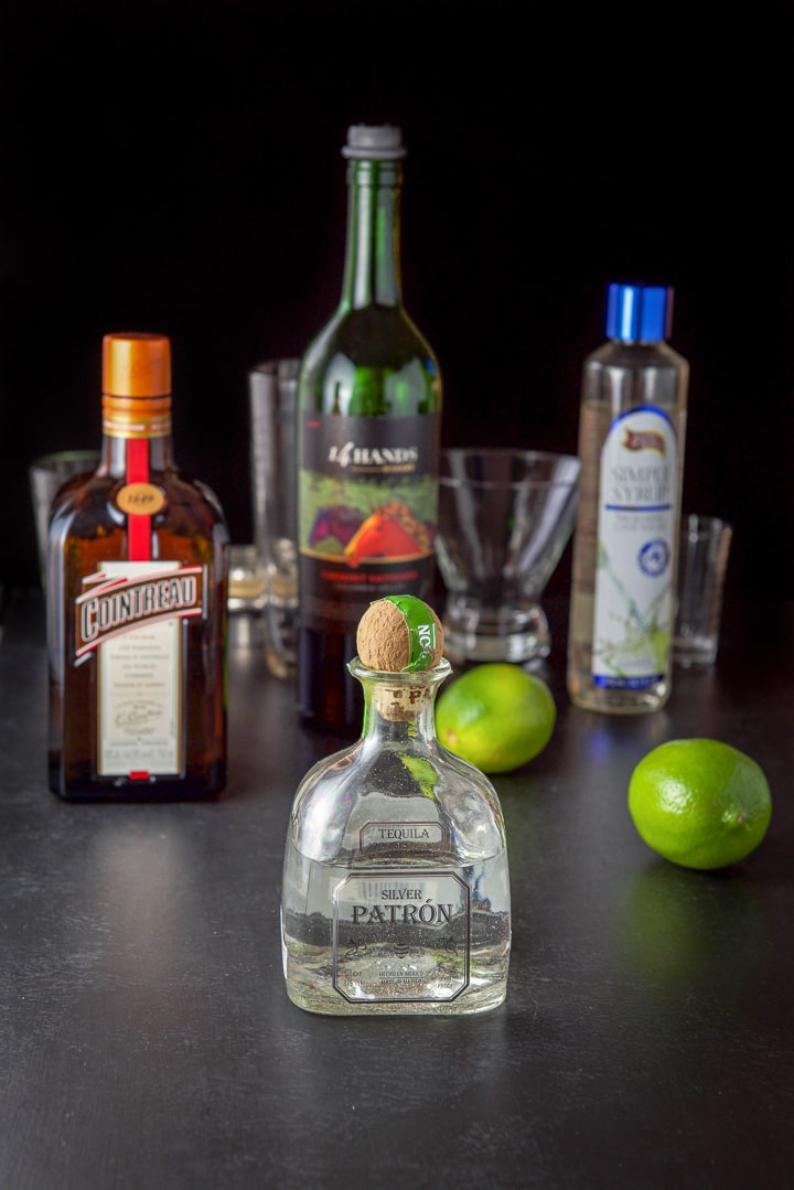 Tequila, Cointreau, simple syrup, limes and wine with the shaker and glassware in the background