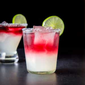 Double old fashioned glass filled with the layered margarita - square