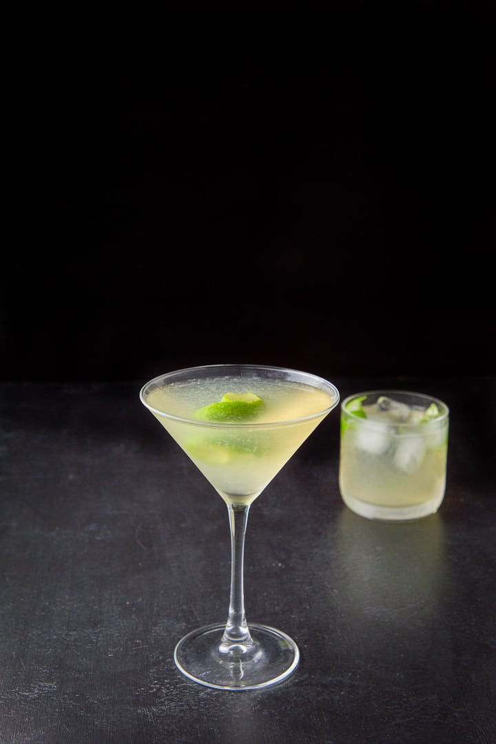The gimlet poured into the glasses with lime twists as garnish