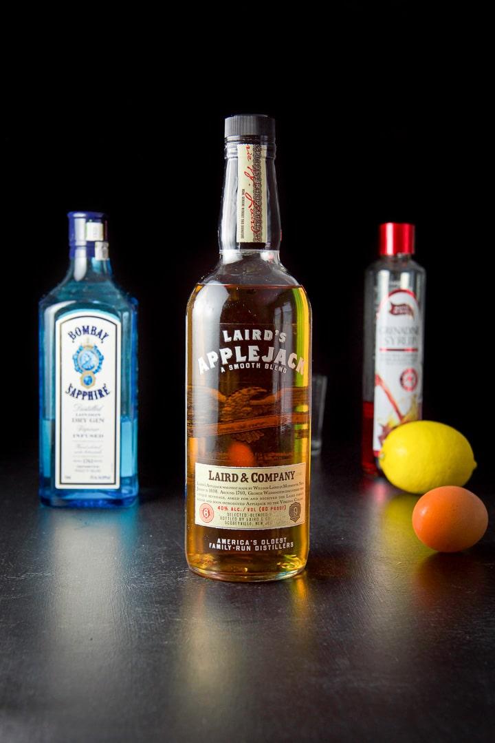 AppleJack liquor, gin, grenadine, lemon and egg for the pink lady cocktail