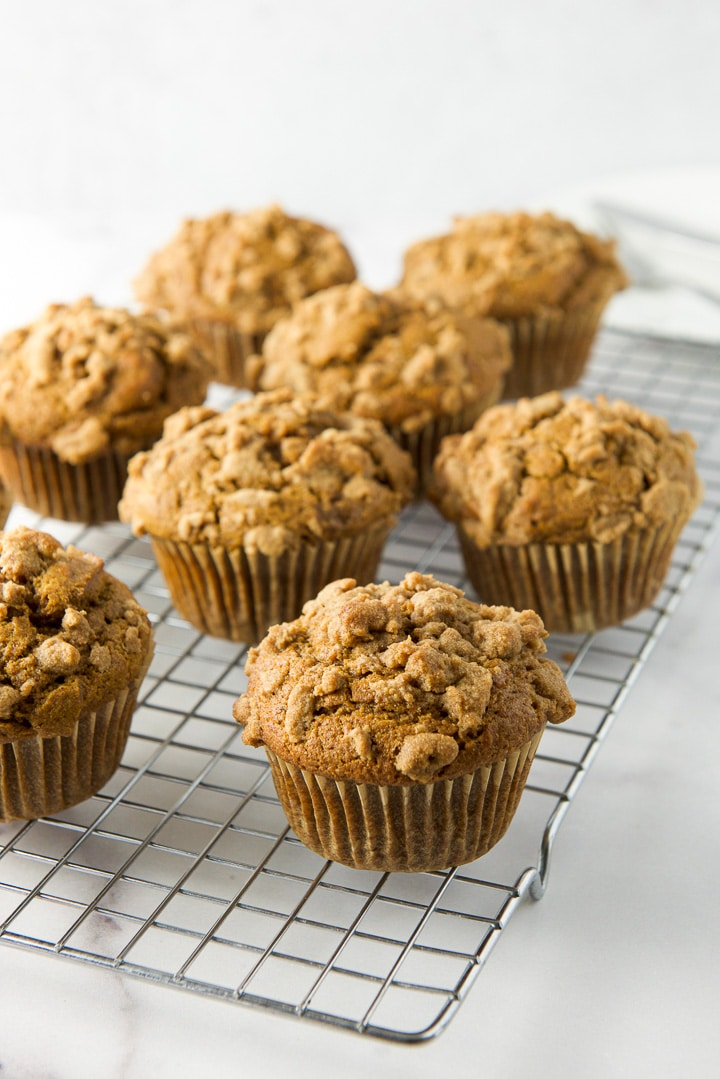 Pumpkin muffins cooling on a wire rack