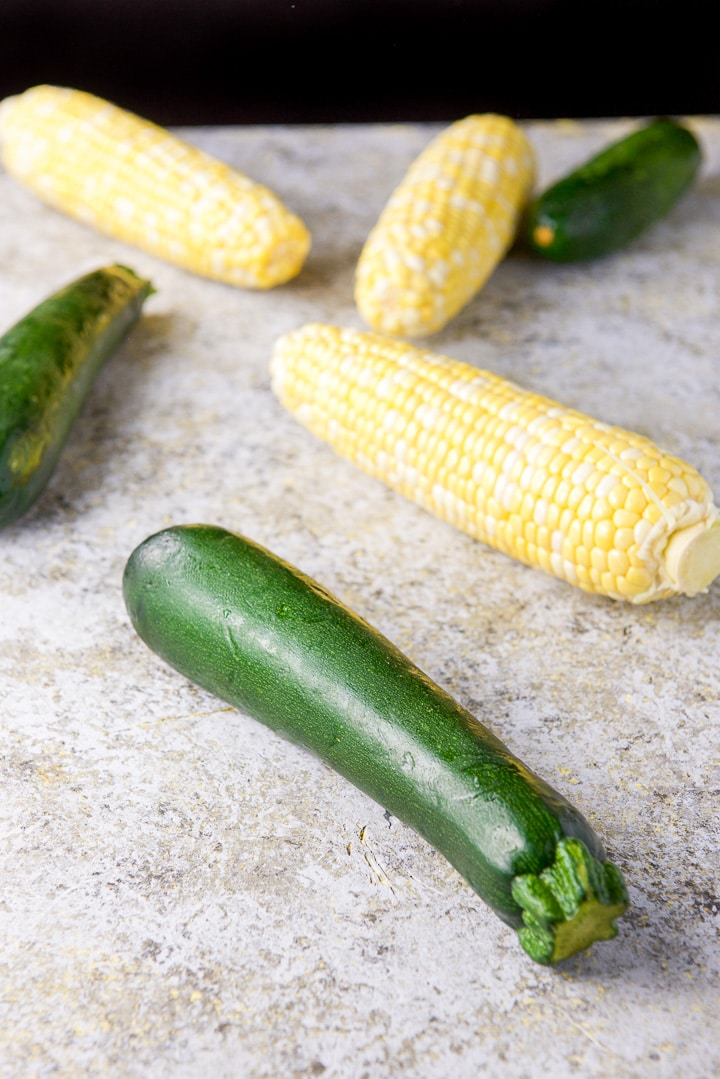 Zucchini and corn on a table for the soup