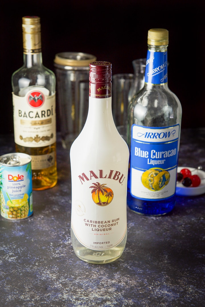 Coconut rum, gold rum, blue curacao and pineapple juice for the sweet poison cocktail