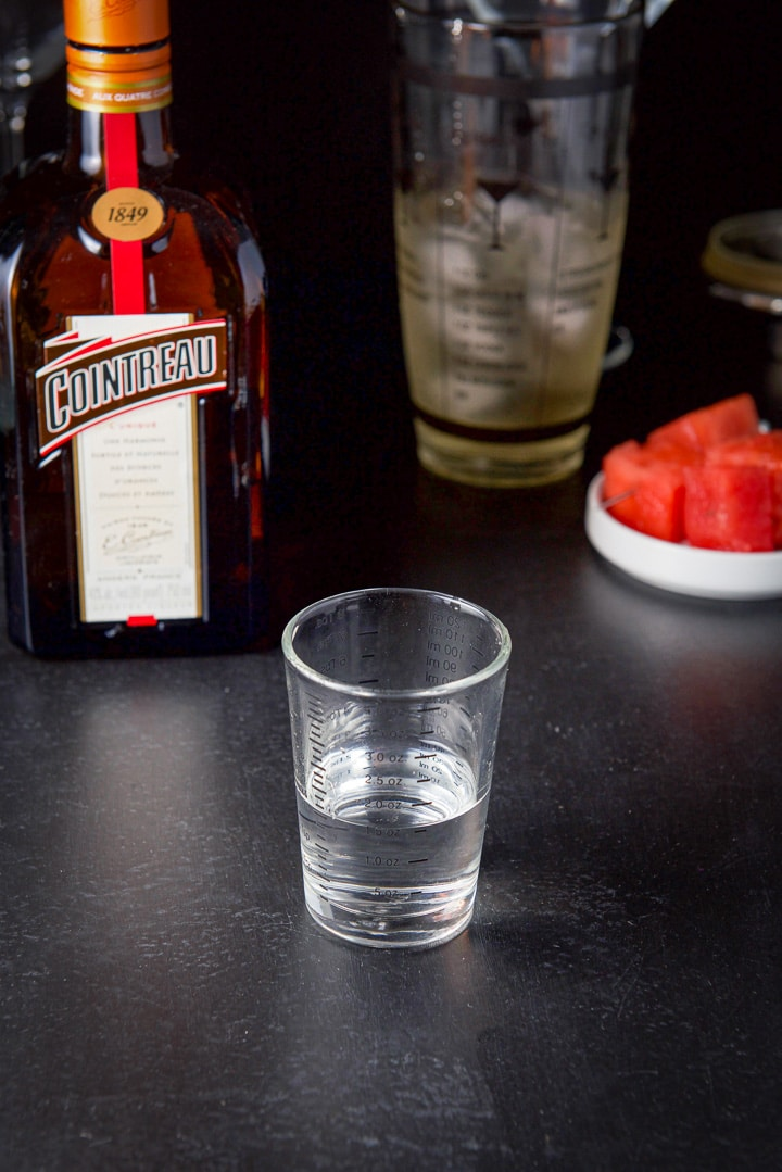 Cointreau measured out with the bottle in the background