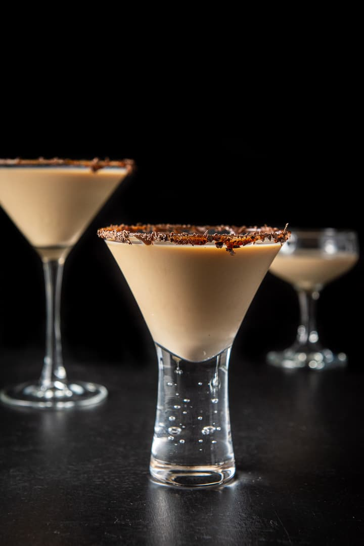 Vertical view of the short glass with the chocolate martini in front of the other glass
