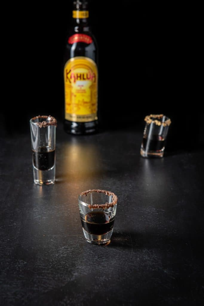Coffee liqueur poured into the garnished glasses