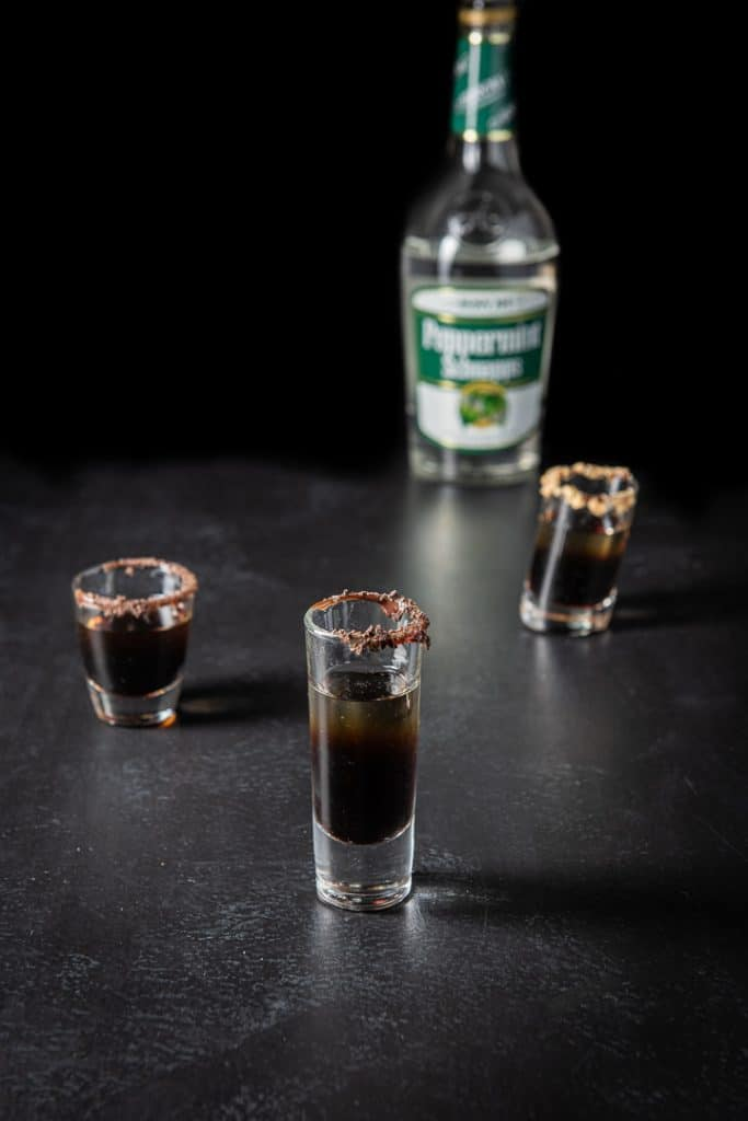 Peppermint schnapps layered in the three glasses