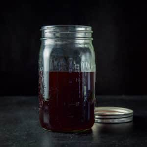 A jar of cherry infused bourbon - square