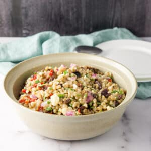 Farro salad in a beige bowl - square