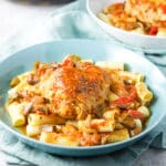 Square photo of two bowls with the chicken cacciatore on pasta