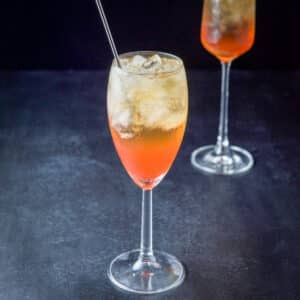 Classic orange cocktail in a white wine glass - square