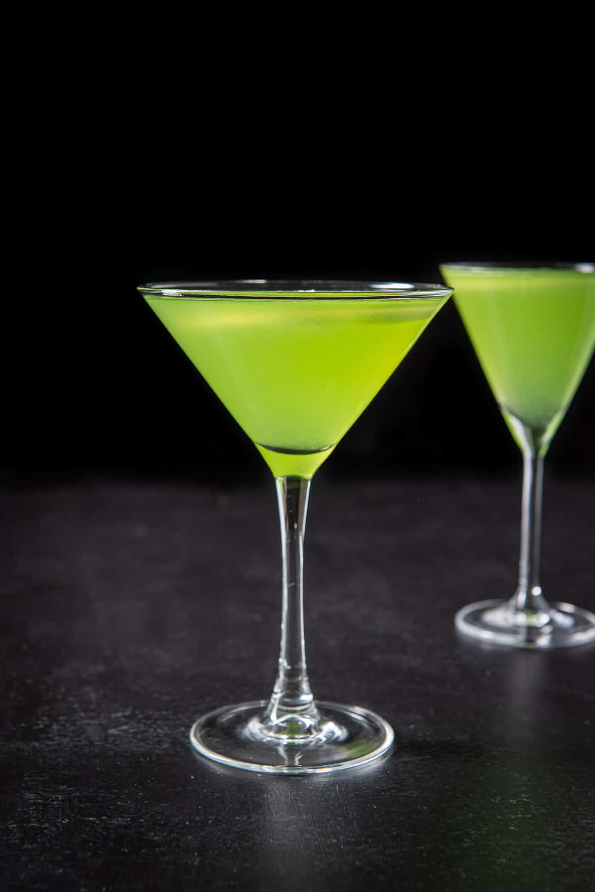 Vertical view of the green cocktail in the classic martini glass