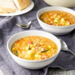 Grey bowl of vegetable soup - square