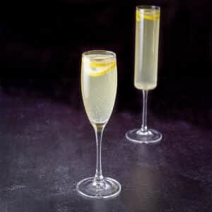 the classic champagne glass in front of the straight glass - square