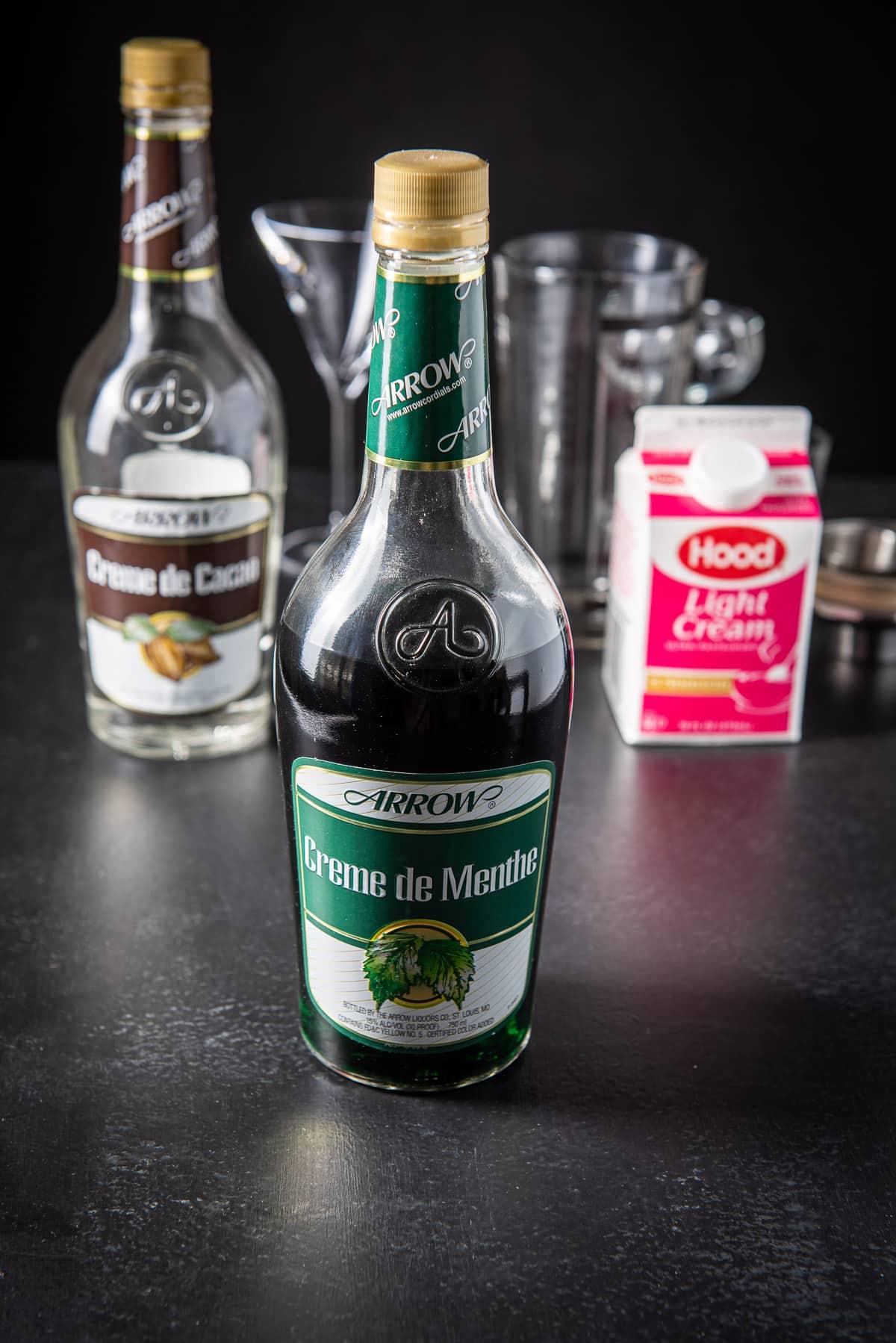Green creme de menthe, creme de cacao and cream for the grasshopper cocktail