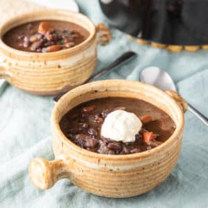One crock of black bean soup with sour cream - square