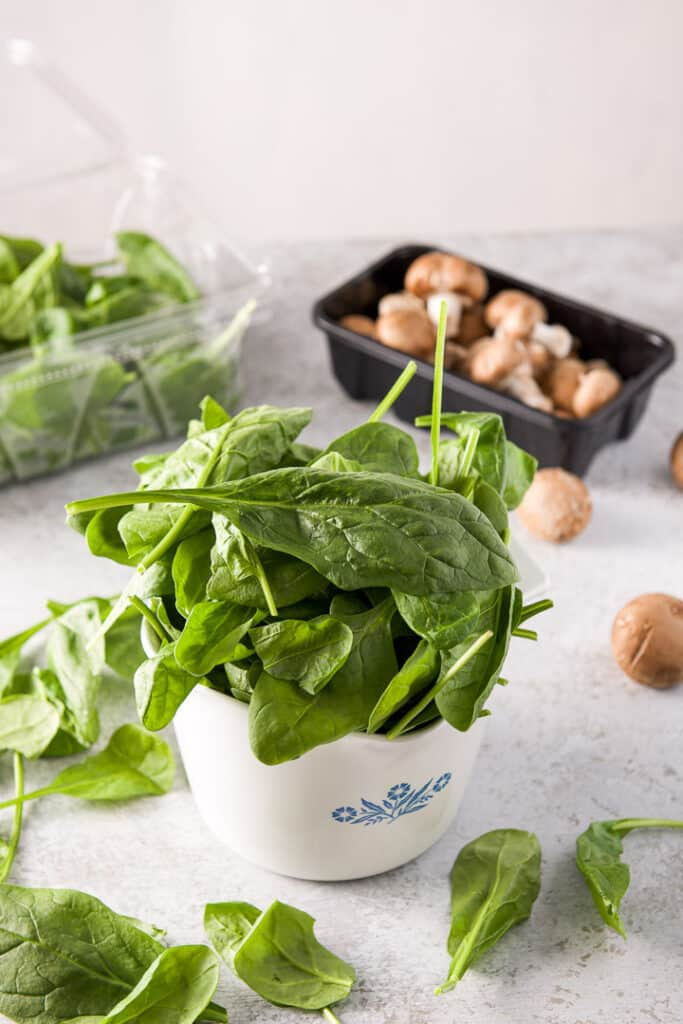 Spinach and mushrooms in a bowl