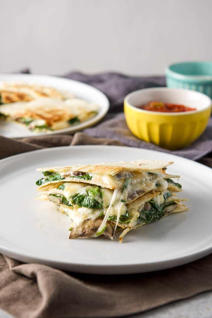 Vertical closeup of the mushroom and spinach quesadillas