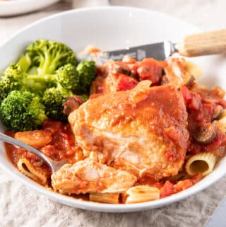 Square photo of the chicken marengo on a white plate with broccoli
