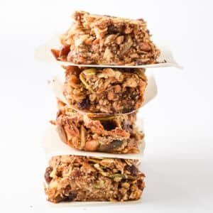 A stack of four granola bars tilting to the right with a white background