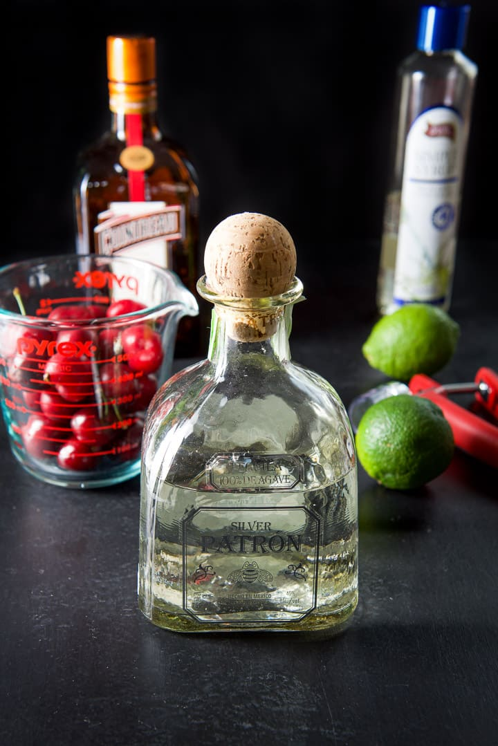 Tequila, Cointreau, simple syrup, limes and cherries for the cocktail