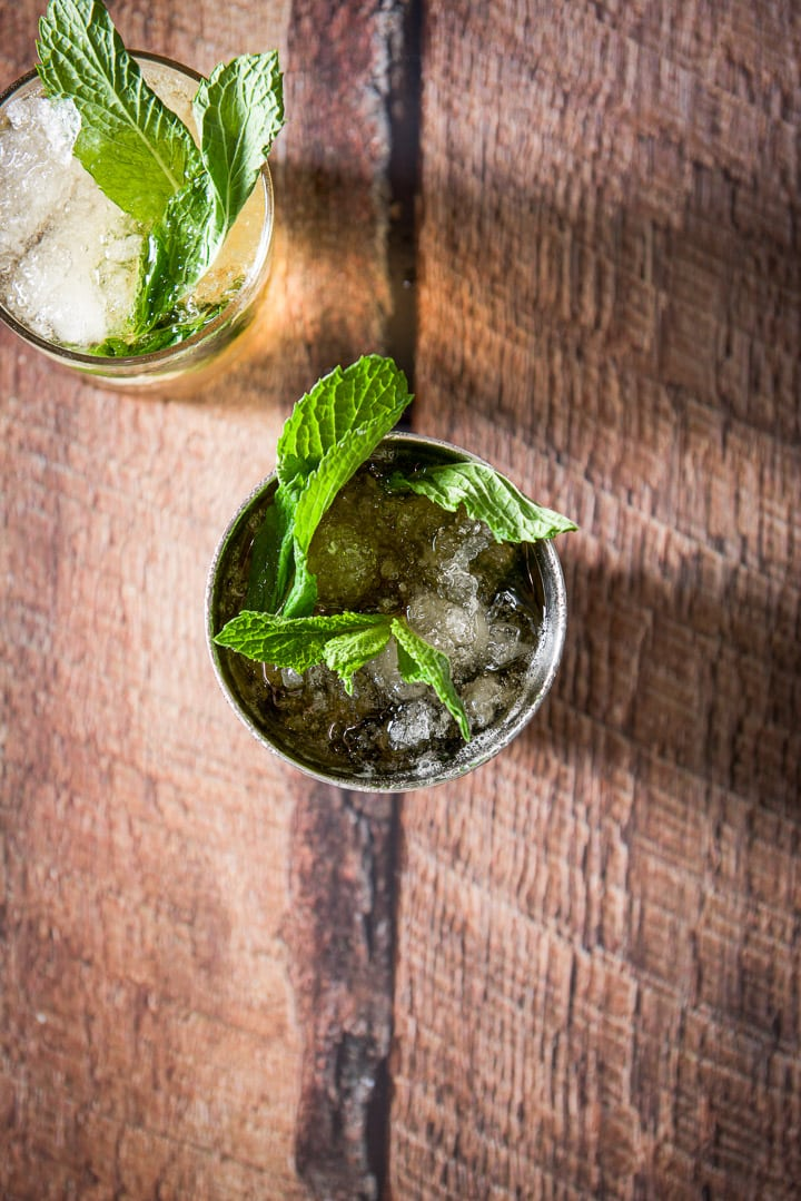 Overhead view of the two glasses filled with the julep with mint sticking out of the glasses