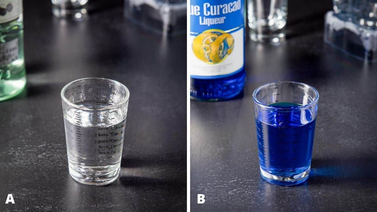 Rum and blue curacao poured out with the bottles in the background
