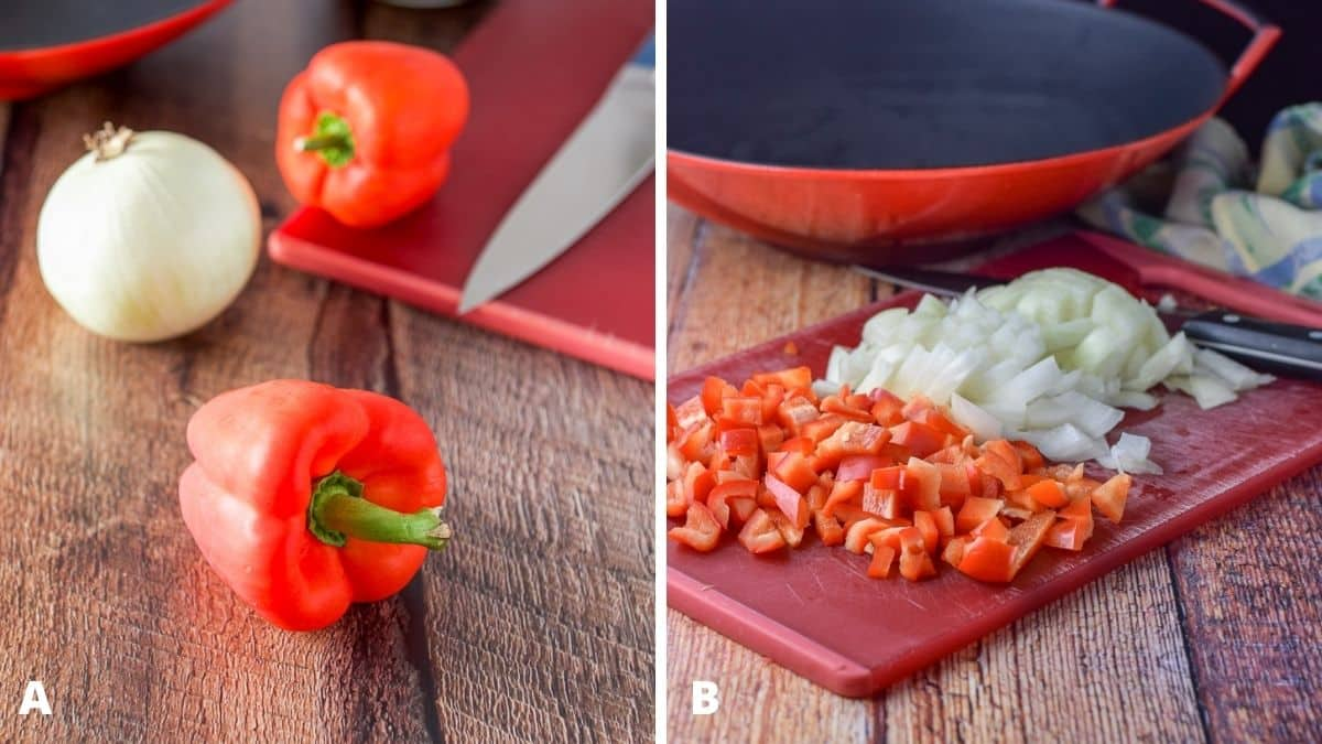 Red bell peppers and onions both whole and chopped on a red board with a wok in the background