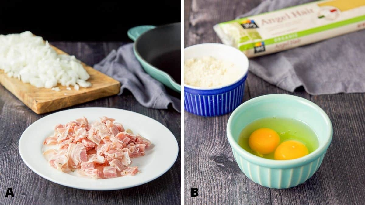 On the left - Pancetta on a plate with chopped onion on a wooden board. On the right - eggs in a green bowl, cheese in a blue bowl and angle hair pasta on the table