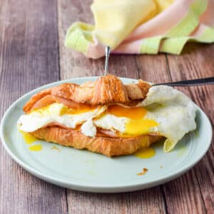 A croissant with cheese, egg and ham - square