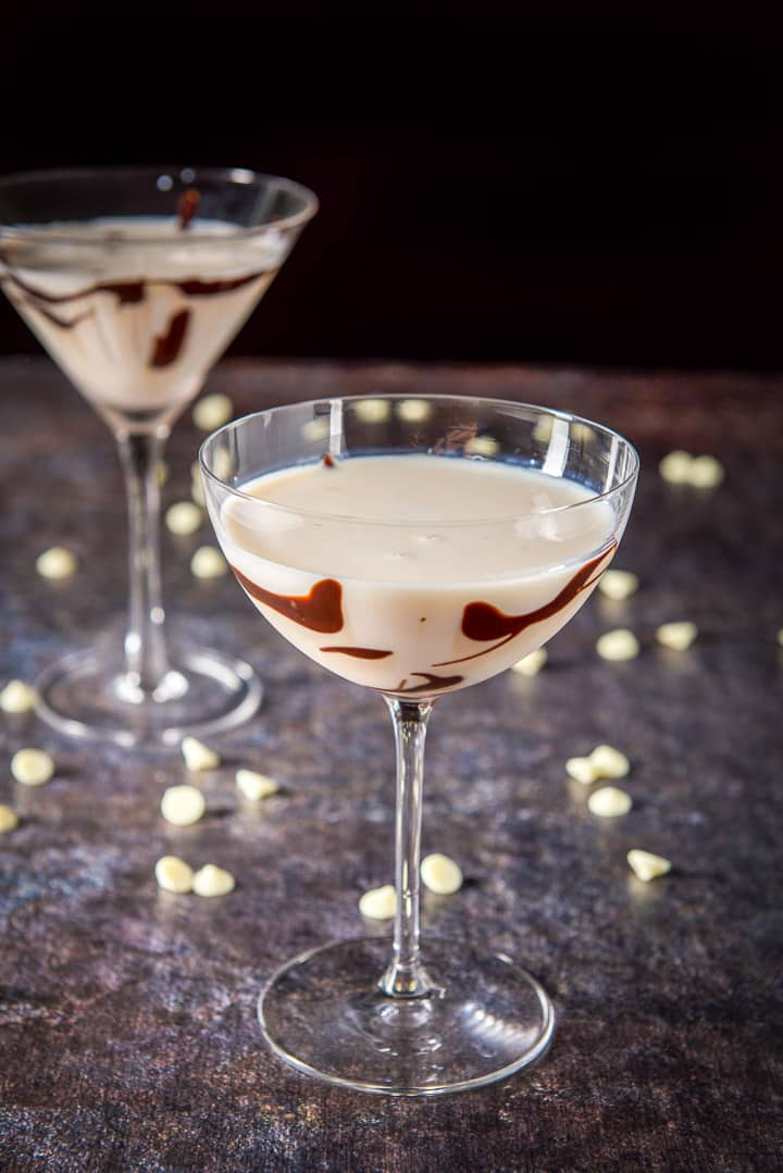 A bowl glass filled with the chocolate sauced glass filled with the cocktail