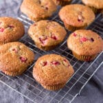 Cranberry muffins cooling on a wire rack - square