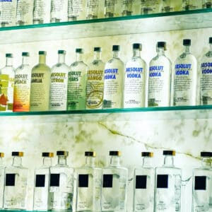 Three rows of vodka on shelves - square