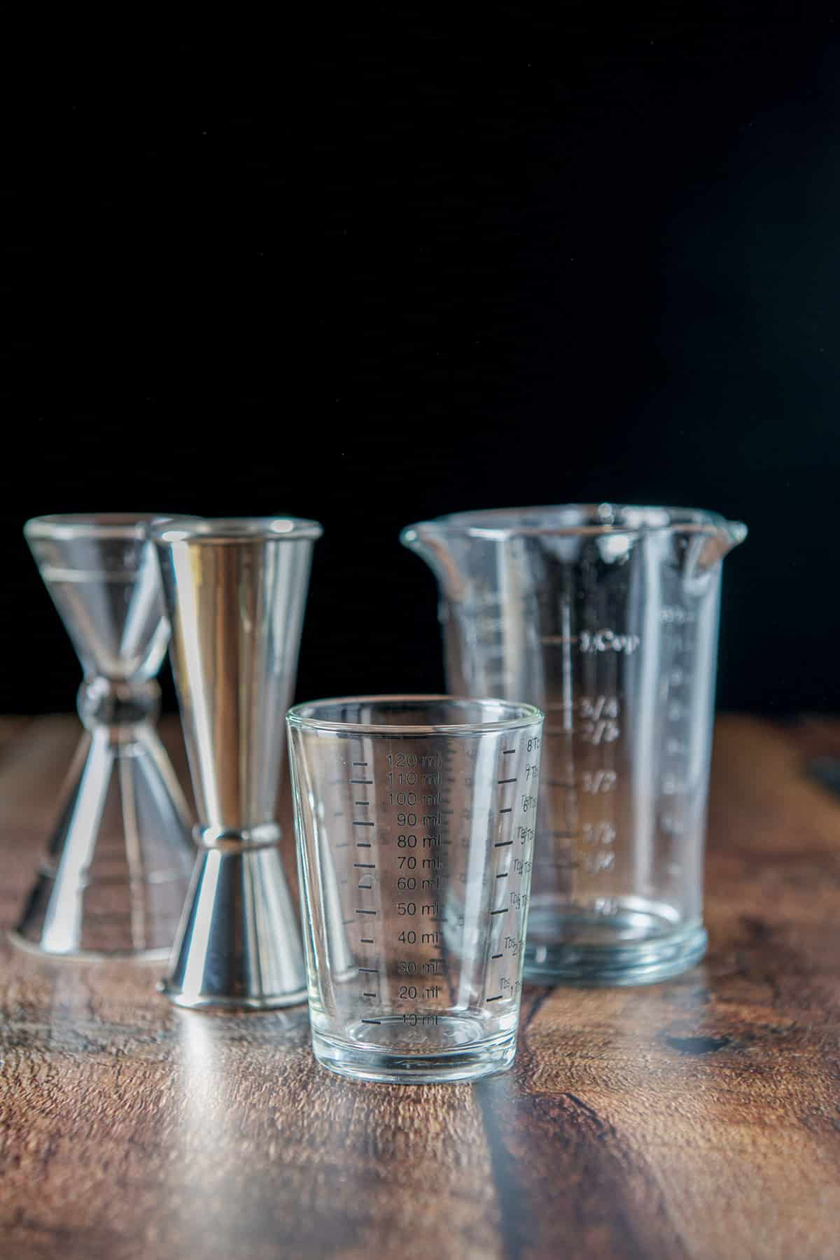 Different jiggers and measuring glasses