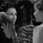 Judith Anderson shows Joan Fontaine a fur coat in Rebecca