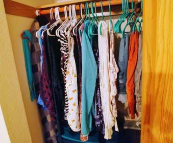 Anna's fashion resolutions. Clothes neatly organized on hangers